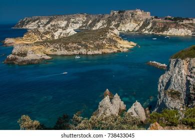 Tremiti islands with blue water, boats and sky. Gargano. Puglia