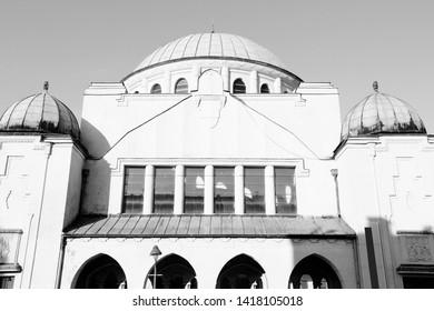 Trencin, city in Slovakia in Povazie region. Jewish synagogue. Black and white retro style.