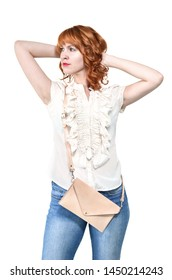 TRENCIN, SLOVAKIA - JUNE 16, 2019: Young woman in jeans and blouse on white background with leather purse bag.
