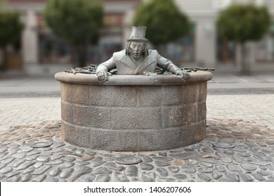 """TRENCIN, SLOVAKIA - MAY 18, 2019: Fountain with sculpture of kelpy in Trencin. His name is """"Valentín"""". Touristical attraction in Trencin - famous slovak city."""