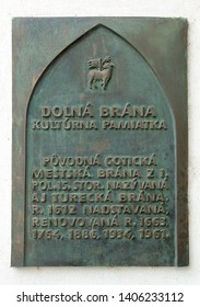 TRENCIN, SLOVAKIA - MAY 18, 2019: The bronze table placed on City Tower (Lower Gate) in Trencin. Western Slovakia. Central Europe. Bronze guide sign, located on the wall.