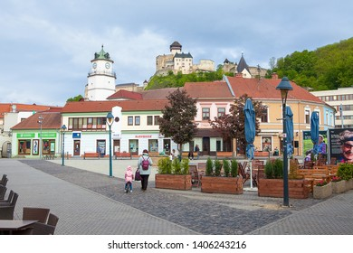 TRENCIN, SLOVAKIA - MAY 18, 2019: Sturovo square in Trencin with Trencin castle and Town Tower in the background. Slovak Republic, Central Europe