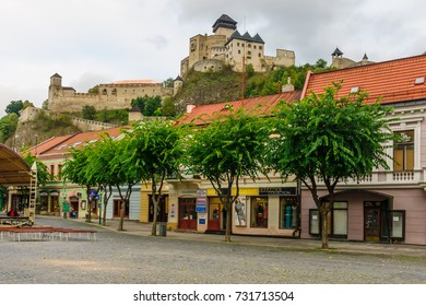 TRENCIN, SLOVAKIA - SEPTEMBER 23, 2013: View of the old center and the castle, with locals and visitors, in Trencin, Slovakia