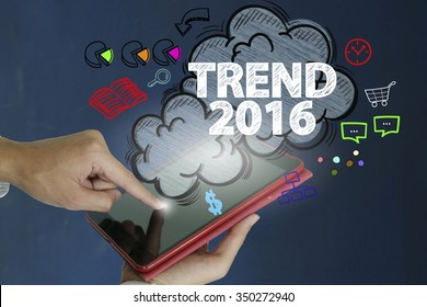 TREND 2016 over a tablet computer on dark blue background , business concept