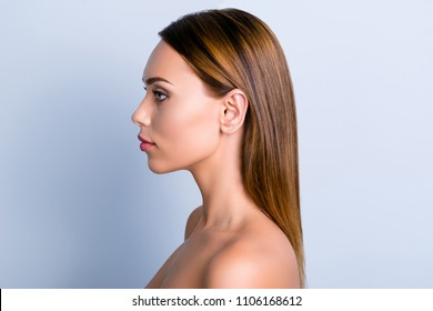 Trend dermatology purity medicine lotion ear rhinoplasty nose wellness concept. Profile portrait of beautiful woman with ideal smooth nourished hairdo isolated gray background