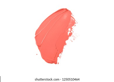 Trend photography on the theme of the actual colors for this season - a shade of orange. Bright smear of foundation in the form of a group of diagonal strokes isolated on a white background.