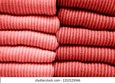 Trend photography on the theme of the new color of the year 2019 - Living Coral. Handmade knitting wool texture background of New trending Living Coral color