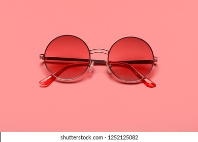 Trend photography on the theme of the new color of the year 2019 - Living Coral. Beautiful trendy sunglasses.