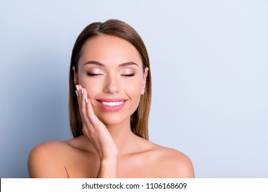 Trend style stylish glamour dermatology therapy balm hydration lotion cheekbones scrub hair care concept. Close up portrait of cute girl enjoying ideal skin isolated on grey background
