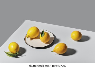 Trending colors of 2021. Yellow illuminating lemons on Ultimate gray tablecloth. Isometric view minimal still life. - Shutterstock ID 1875937909