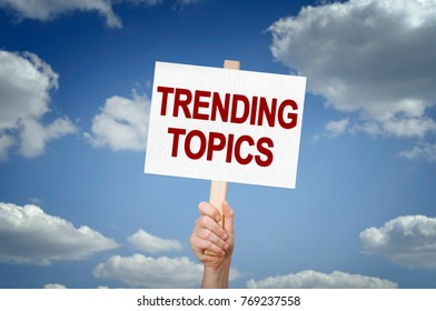 Trending Topics placard with sky background
