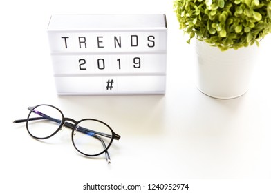 TRENDS 2019 text on lightbox composition on white table background,Business Concept.