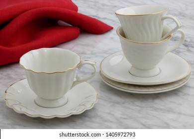 trendy and beautiful antique porcelain tea cups styled on carrara marble table