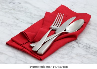 trendy and beautiful silverware set styled on linen double hemstitch napkin and antique carrara marble