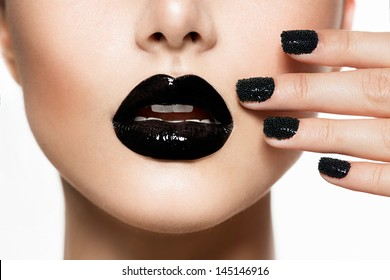 Trendy Black Caviar Manicure and Black Lips. Fashion Makeup and Manicure. Nail Art