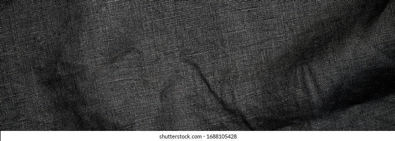 Trendy black linen texture. Natural flax fabric background.  Eco friendly raw sack cloth pattern. Burlap daark grey organic canvas