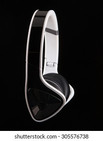 Trendy black and white Headphones on a black background.