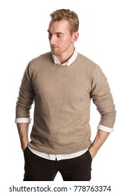 Trendy blonde man standing against a white background in brown pullover shirt. White background.