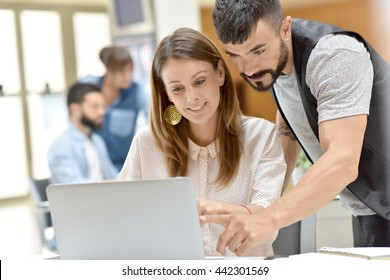 Trendy business people working on project