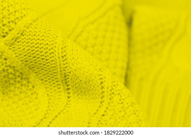 Trendy color green sheen background. Full frame shot of knitted fabric background
