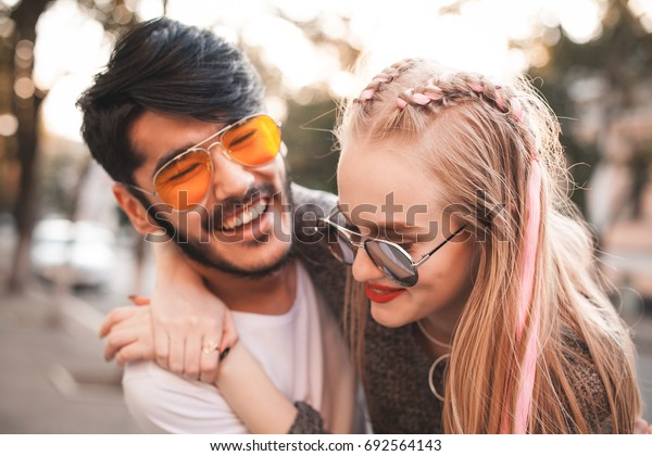 Trendy couple is having fun in the city.