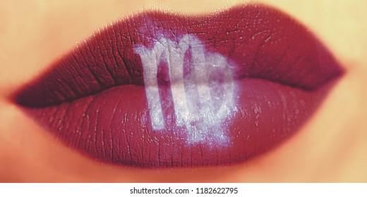 Trendy Creative lip makeup. Closeup Shiny glossy lips with Virgo Zodiac Sign. Women Horoscope.