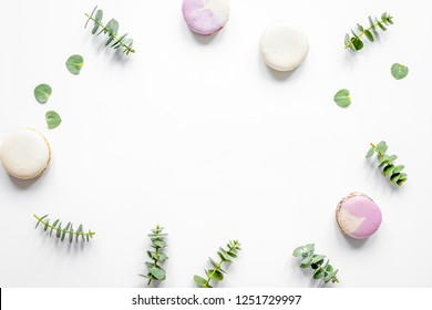 Trendy design with macaroons and flowers on white background top