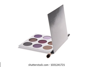Trendy eye shadow palette in purple colors, isolated on white background