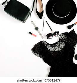 Trendy fashion black styled woman clothes and accessories collection on white background. Flat lay, top view. Dress, high heels, sunglasses, purse, watches, hat.