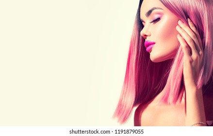 Trendy fashion hairstyle, bob haircut, ombre pink with grey dyed hair. Beauty Model girl with perfect healthy hair and beautiful makeup posing, young woman portrait border design with copy space