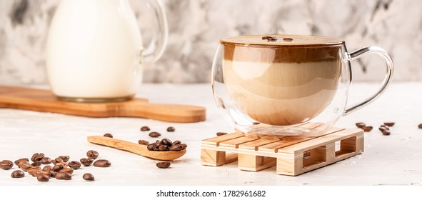 trendy fluffy creamy whipped coffee, Iced Dalgona Coffee on a light background, Long banner format.