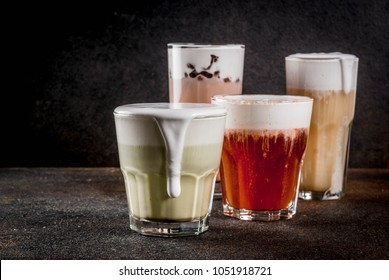Trendy food and drinks, assortment 4 kinds of Cheese Tea with whipped cream cheese, on dark background