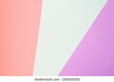 Trendy geometric diagonal abstract texture of pink, violet and blue papers. Design background concept