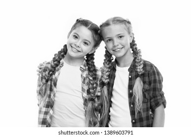 Trendy girls. Dress similar with best friend. Dress to match your friend. Best friend dressing. Friends wear similar outfits have same hairstyle braids white background. Sisters family look outfit.
