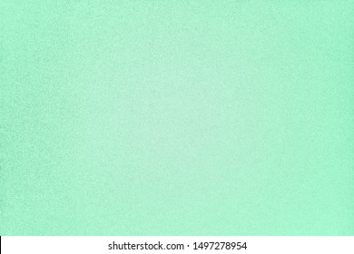 Trendy green quiet wave colored paper texture. Abstract paper background in light green mint trend color. Pastel Seafoam Green, Pale green, cyan quiet wave  concrete rough surface. Metallic shimmers
