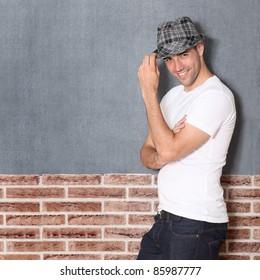 Trendy guy on urban background