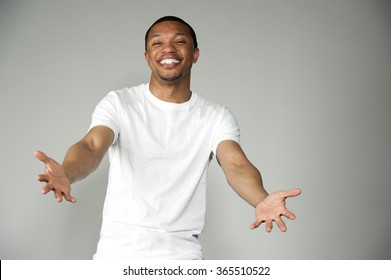 Trendy Happy and Fun Black Male Wearing A White Top