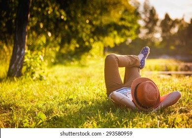 Trendy Hipster Girl Relaxing on the Grass - Shutterstock ID 293580959