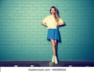 Trendy Hipster Girl at the Turquoise Brick Wall
