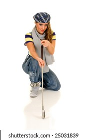 Trendy looking young female golfer, studio shot white background
