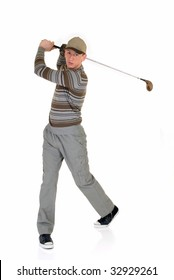 Trendy looking young male golfer, studio shot, reflective surface
