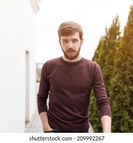 Trendy man with a beard on a sunny day