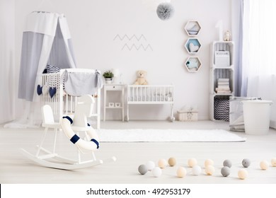 Trendy marine decorations in spacious bright baby room