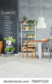 Trendy modern kitchen corner with fresh herbs and plants