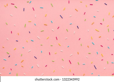 trendy pattern of colorful sprinkles for background of design banner, poster, flyer, card, postcard, cover, brochure over pink