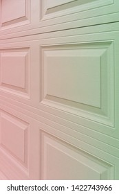 Trendy red to greenish holographic gradient garage door paneling. Colorful background with linear lines & square / rectangular panels that show close up perspective. Holo 90 / 80 style squared shapes