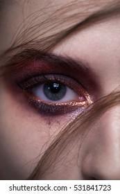 Trendy red makeup eyes closeup.