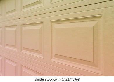 Trendy red to yellowish holographic gradient garage door paneling. Colorful background with linear lines & square / rectangular panels that show close up perspective. Holo 90 / 80 style squared shapes