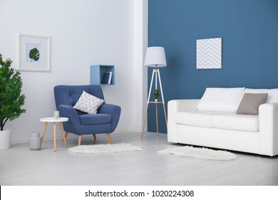Trendy room interior with modern color armchair