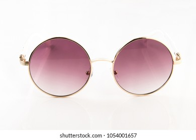 Trendy round rose glasses isolated on a white background